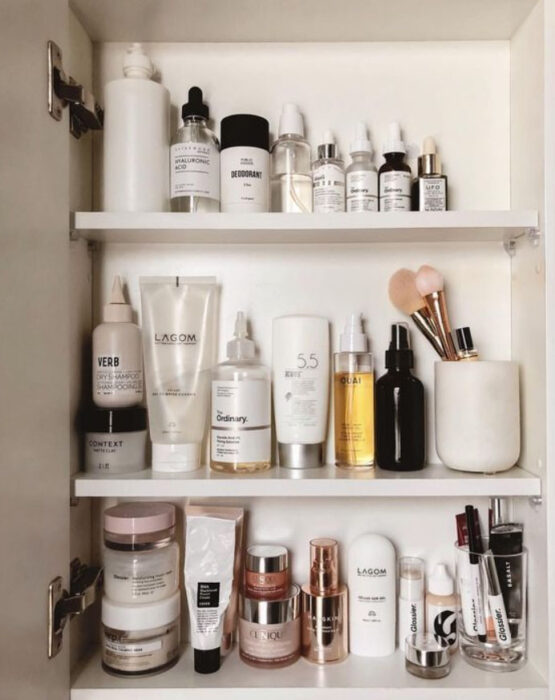 Organization of makeup and skin care inside the bathroom mirror doors