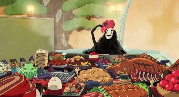 Escena de la película 'El viaje de Chihiro', en la que se ve el banquete con toda la comida rica que no se pueden comer