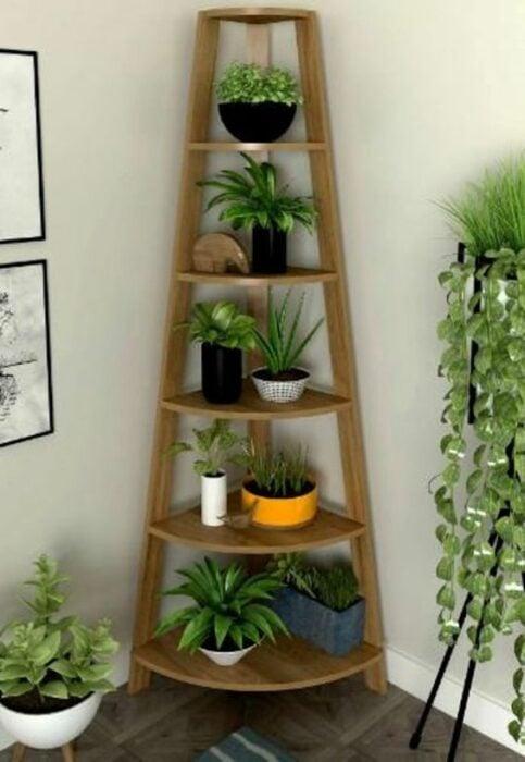 Decoración del hogar de un esquinero para colocar plantas estilo Pinterest