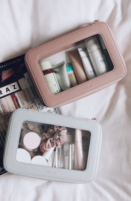 Organization of makeup and skin care in colored toiletry bags