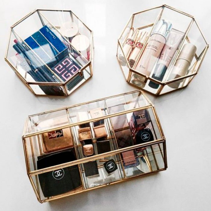 Organization of makeup and skin care in glass containers with metal frame