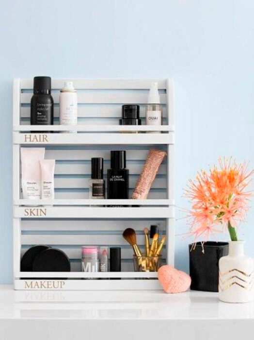 Organization of makeup and skin care on shelves on the wall