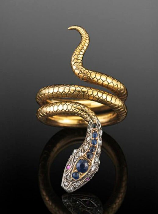 Snake-shaped ring with blue stones on the head