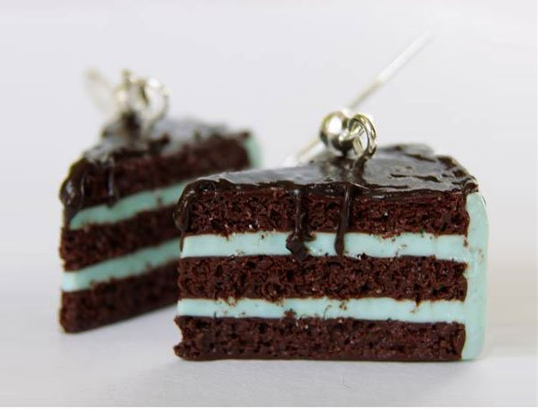 Small earrings in the shape of a slice of cake