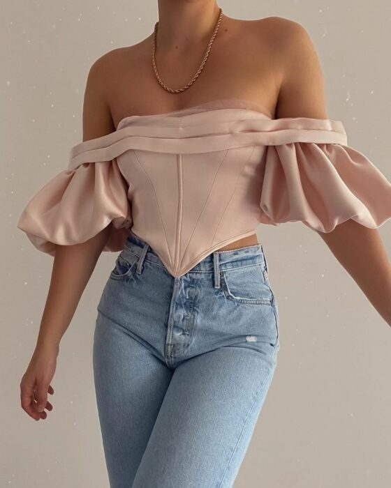 Girl in a pink corset style blouse