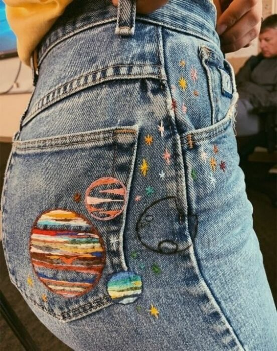 Embroidered on jeans of planets in different colors