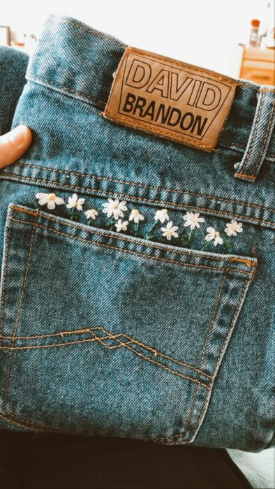 Small daisy embroidery on jeans
