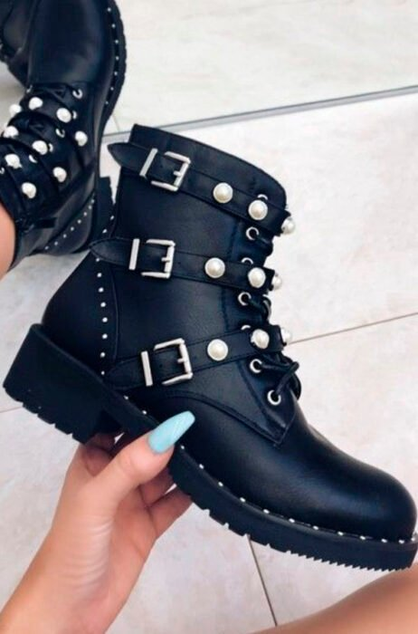 Chunky boots in black with straps that have pearls