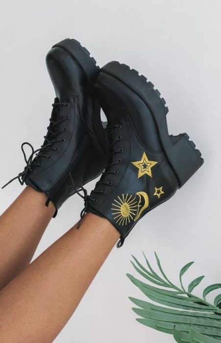 Black chunky boots with a little heel and embroidery on the side of stars and sun