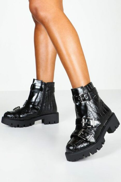 Black patent leather chunky boots with snakeskin type and various straps