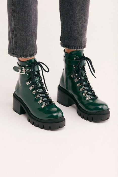 Military green chunky boots, with black strap and laces and black platform