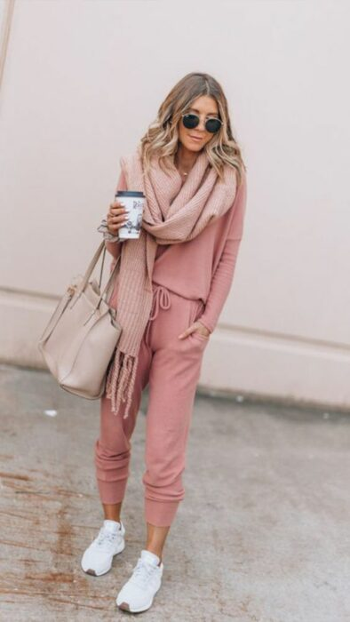 Girl wearing long baby pink scarf and pale pink sport outfit