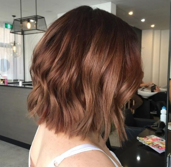 Girl with bob cut and chestnut dyed hair