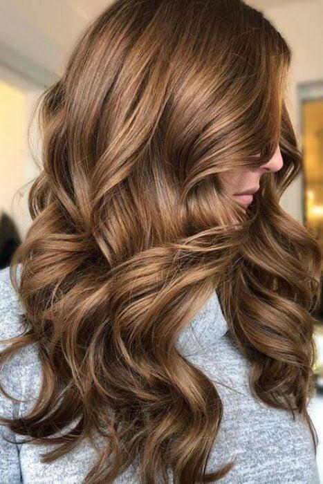 Girl in profile showing caramel gold hair