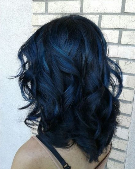 Girl with midi hair dyed in bluish black