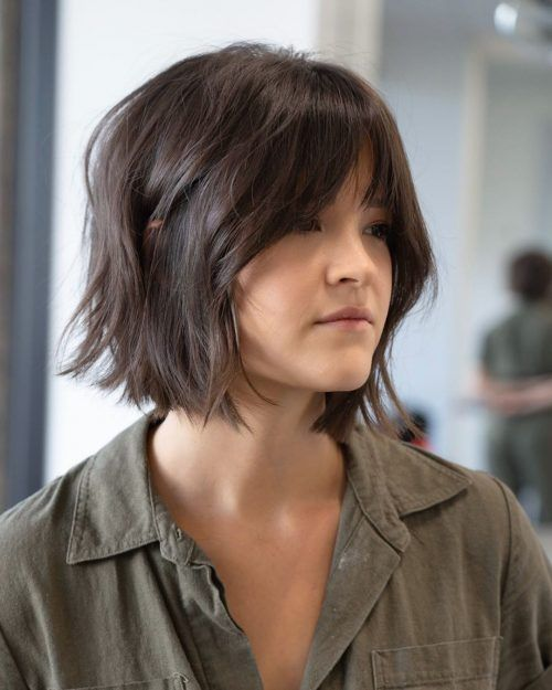 Girl with short dark hair with faded fringe