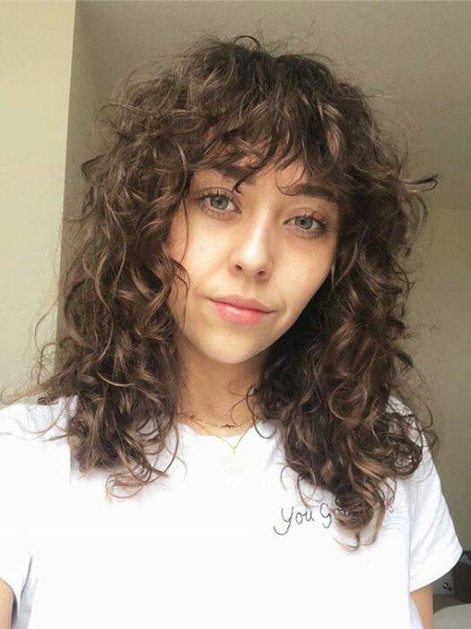 Curly chestnut girl with slag cut