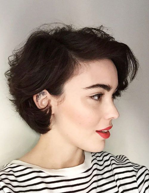 White girl in black and white striped blouse with short curly hair