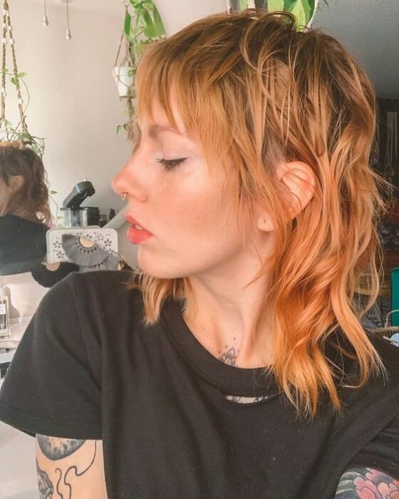 Redhead girl with mullet cut