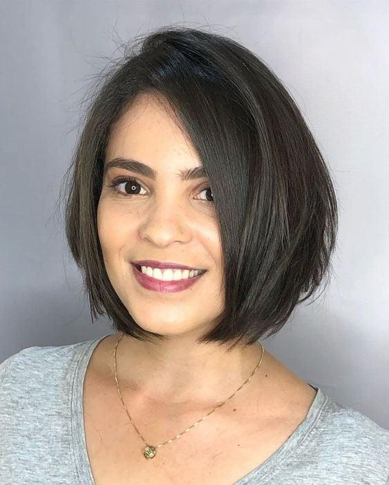Brunette girl with short dark hair in gray shirt
