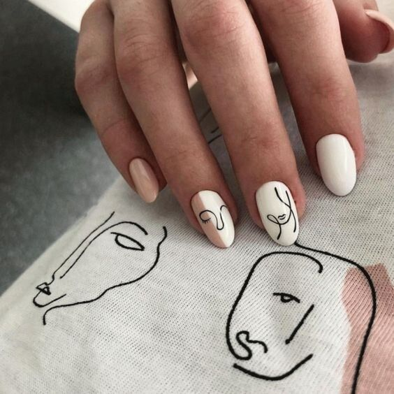 White manicure with pastel pink and black outlines