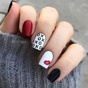 Manicure in white, black and red colors with delayed lips