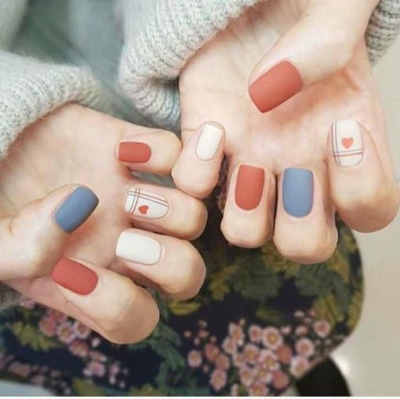 Manicure in brick red and sky blue tones