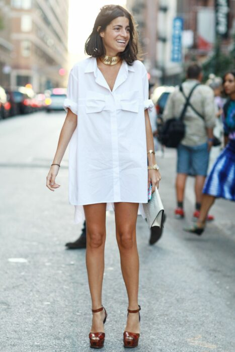Girl wearing a long white shirt style dress