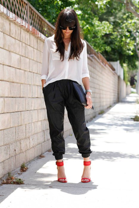 Girl wearing a white button-down shirt with black pants and red shoes