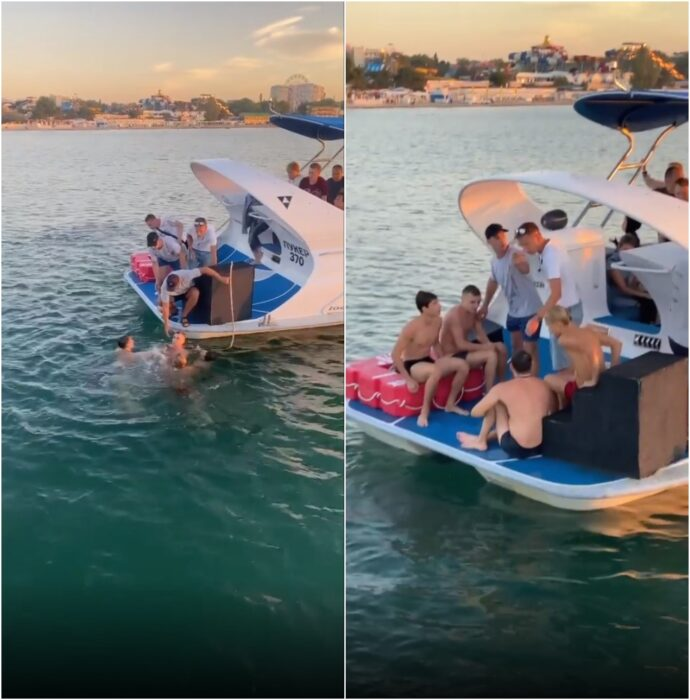 Hombres subiendo a un yate luego de casi ahogarse