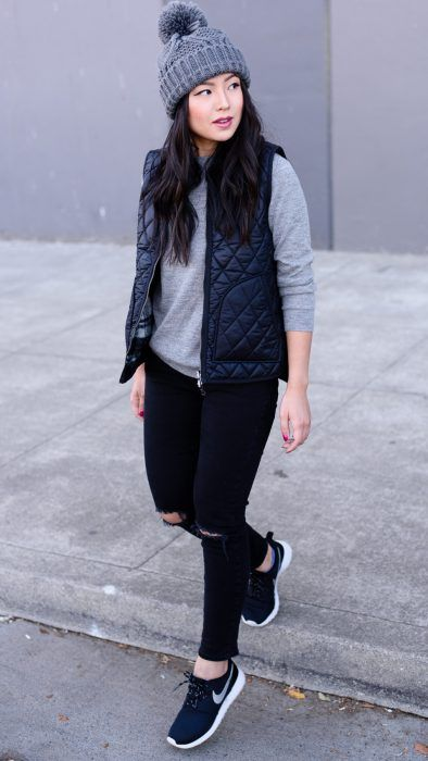 Girl in matching black vest and jeans; ideas to wear a vest during autumn-winter