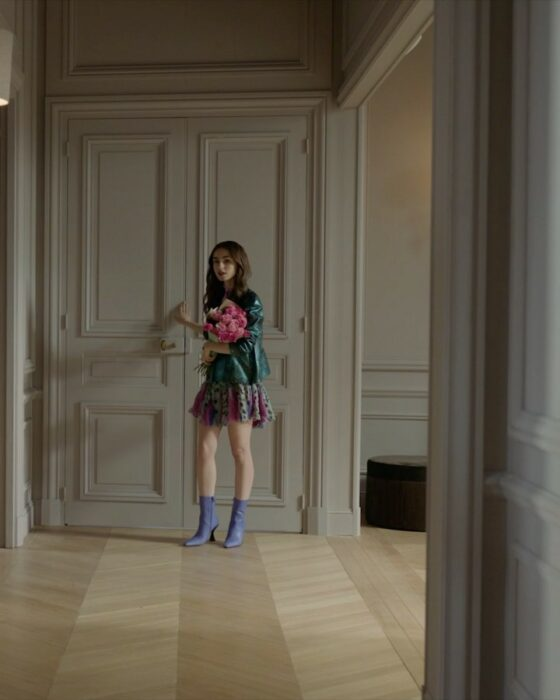 Lily Collins wearing a colorful outfit in Emily in paris
