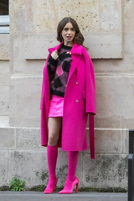 Lily Collins wearing a pink outfit