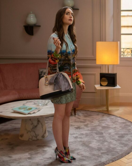 Lily Collins wearing a patterned outfit on the Emily in Paris series