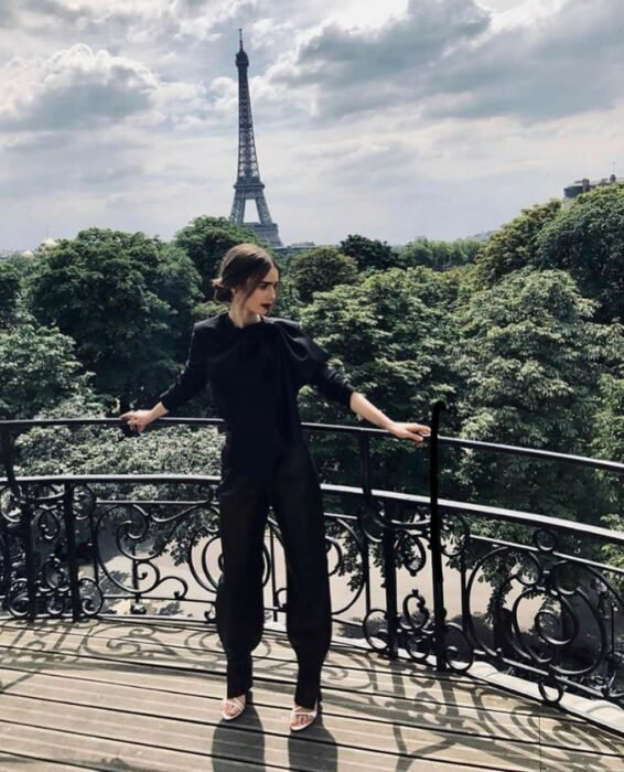 Lily Collins wearing a black outfit in the Emily in Paris series