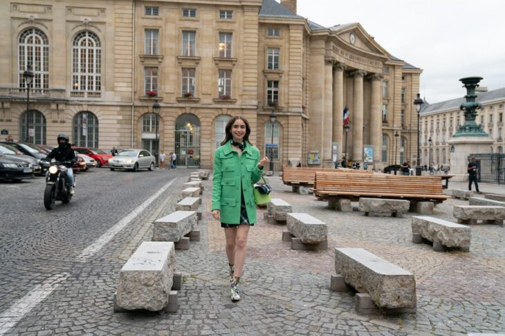 Lily Collins wearing a green coat in the Emily in Paris series