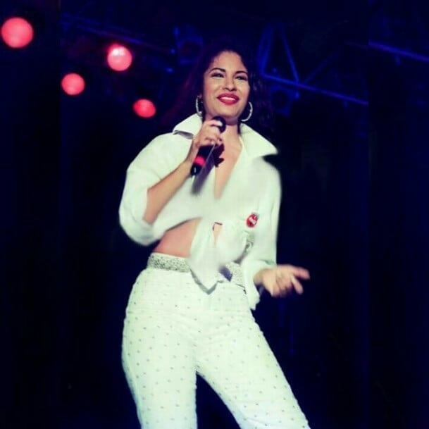 Selena Quintanilla wearing a white outfit