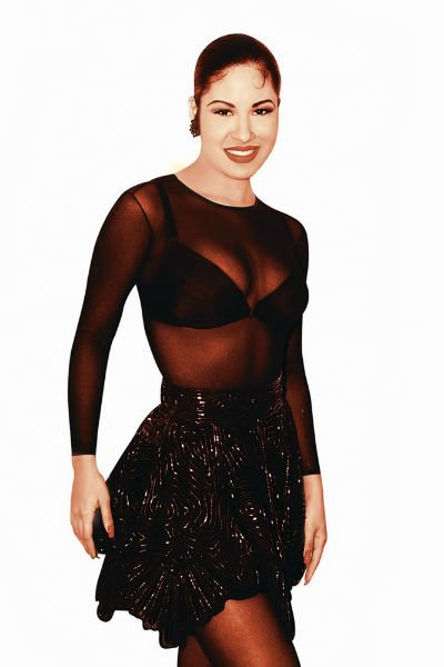 Selena Quintanilla wearing a ruffle skirt with a see-through blouse