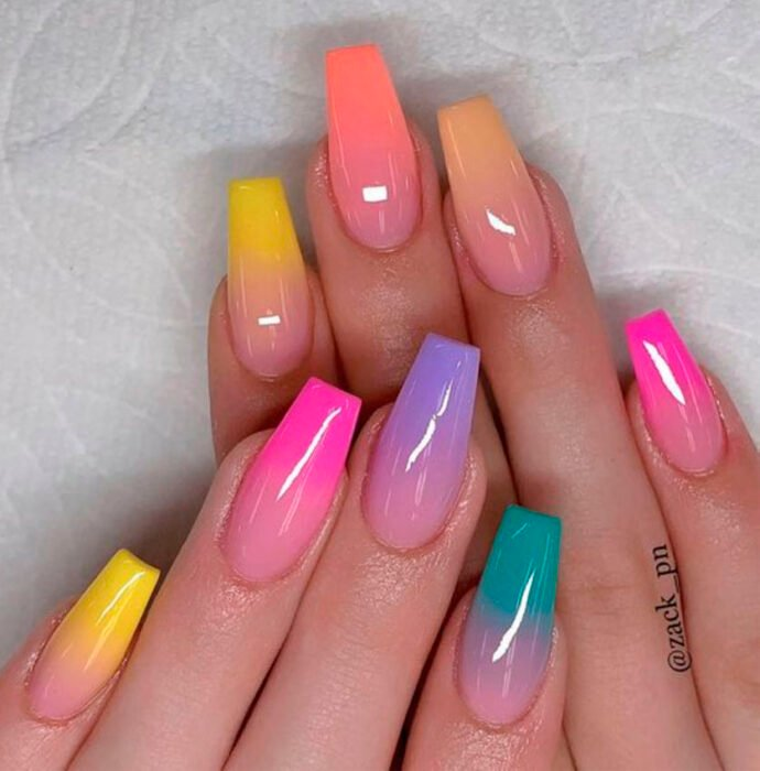 Acrylic manicure aesthetic ombre style, different colors on each nail