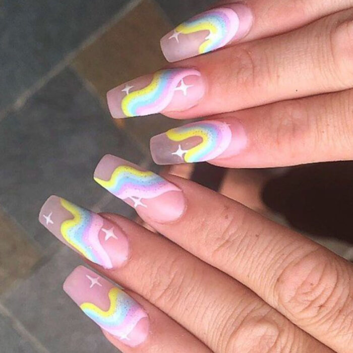 Transparent background aesthetic style acrylic manicure with pastel colors in the shape of curves