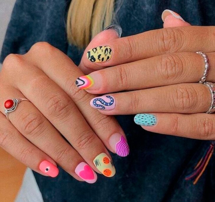 Gelish aesthetic style manicure of different designs on each nail