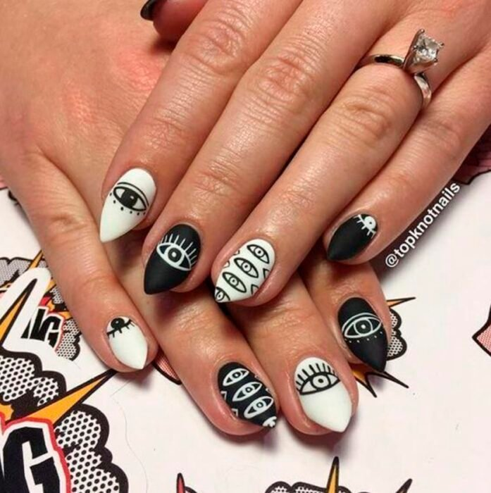 Halloween-inspired manicure in black and white with details of the same colors