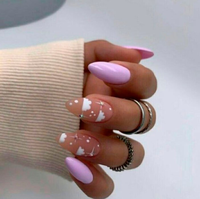 Aesthetic style acrylic manicure in pink, with cloud drawings