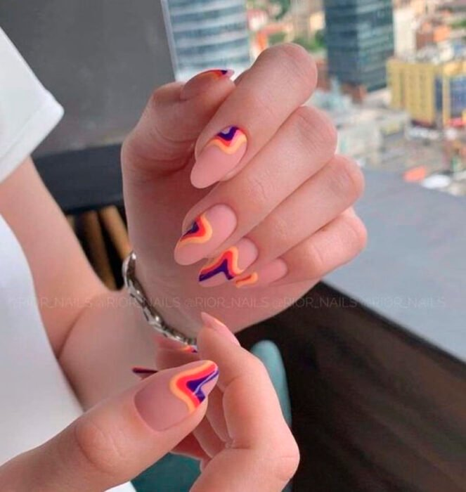 Aesthetic style acrylic manicure with nude background and lines of different colors