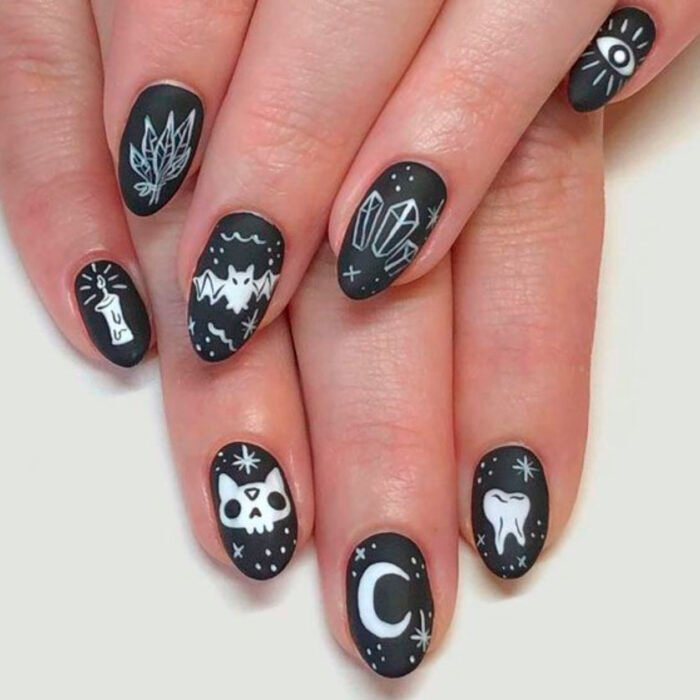 Halloween-inspired manicure with a black background with white details