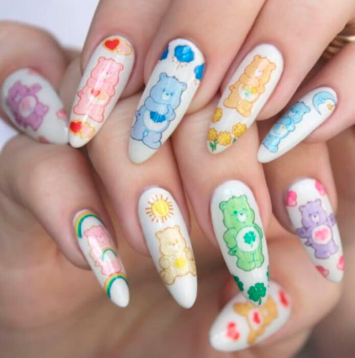Aesthetic style acrylic manicure with a white background with a design of the teddy bears on each nail