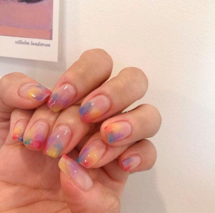 Aesthetic style gelish manicure with rainbow colors on the tip