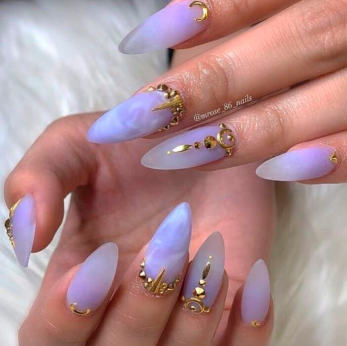 Lilac Halloween-inspired manicure with golden applications