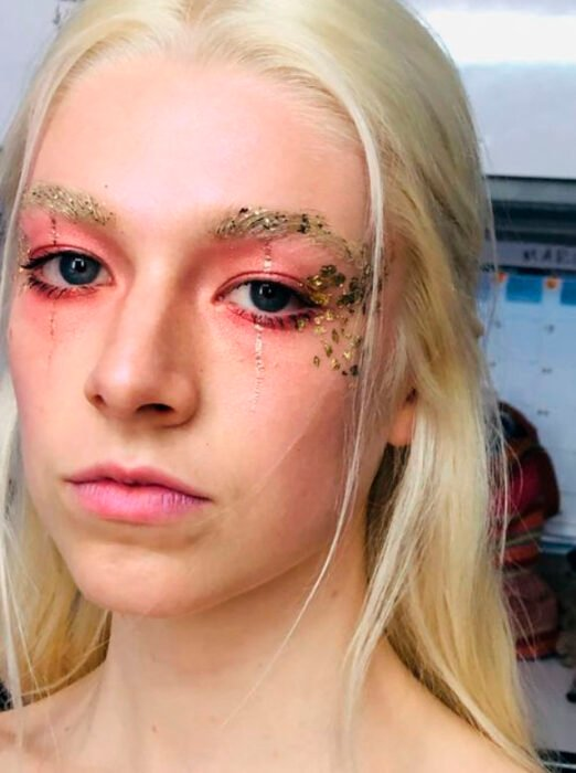 Creative makeup with pink and gold tones