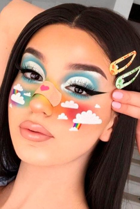 Creative makeup with shades of rainbow and white